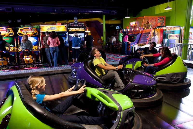 young people ride on the bumper cars